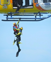 A Person Is Winched Up And Aboard The RACQ CHRS Helicopter During The Mock Rescue-gallery