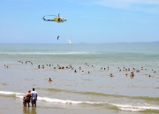 Beach Party Bathers Line Up To Watch the RACQ Capricorn Helicopter Rescue Service In Action-gallery