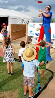 The Beach Party Stiltwalker Keeps The Kids Entertained By Spinning Plates-gallery