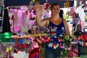 stall holder woman waving at camers-gallery